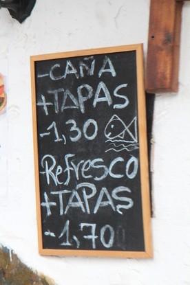Cña + tapa 1,30€. Refresco más tapa 1,70€